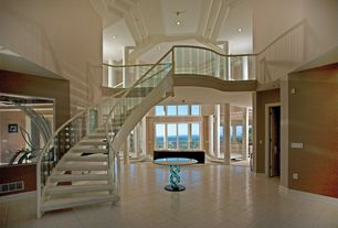 Contemporary Staircase with Loft, High ceiling, stone tile floors, curved staircase