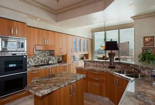 Modern Kitchen with Large Ceramic Tile, double wall oven, Pendant light, Kitchen island, Complex granite counters, Flush