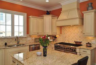 Traditional Kitchen with Custom hood, L-shaped, Raised panel, full backsplash, Kitchen island, Crown molding, Undermount sink