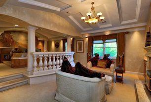 Mediterranean Living Room with insert fireplace, can lights, Carpet, Sunken living room, Standard height, Fireplace, Columns
