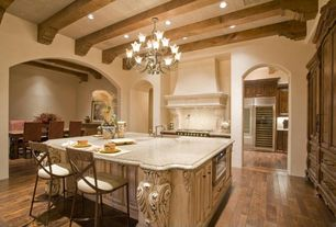 Mediterranean Kitchen with Breakfast bar, Kitchen island, Simple granite counters, Raised panel, Hardwood floors, Chandelier