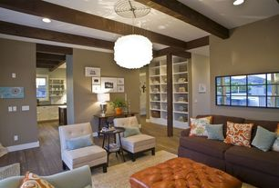 Contemporary Living Room with Paint, Exposed beam, Paint 2, Rounded retro armless chair, Built-in bookshelf, Carpet, Casement