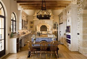 Mediterranean Kitchen with Simple granite counters, Limestone, built-in microwave, Chandelier, Exposed beam, French doors