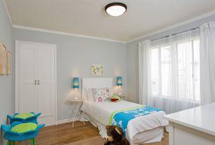 Modern Kids Bedroom with Hardwood floors, flush light, Carpet, six panel door, picture window, Standard height, Crown molding