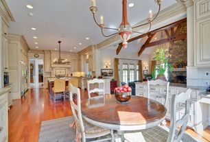 Traditional Dining Room with Wainscotting, Crown molding, Chair rail, Hardwood floors, Chandelier
