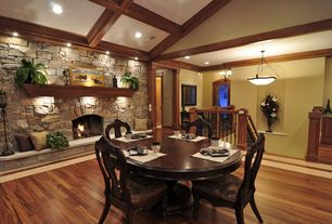 Rustic Dining Room with Box ceiling, Cathedral ceiling, Hardwood floors, stone fireplace