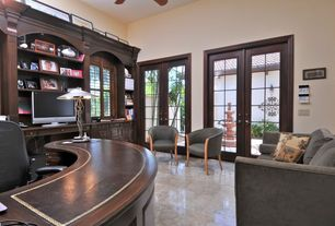 Traditional Home Office with Casement, Concrete tile , Ceiling fan, French doors, Built-in bookshelf, Standard height