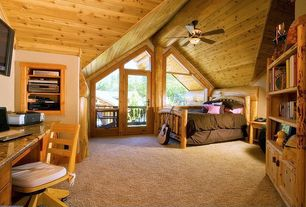 Rustic Guest Bedroom with The log furniture rustic cedar sunburst bed, Built-in bookshelf, Ceiling fan, Cathedral ceiling