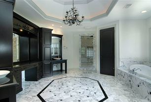 Traditional Master Bathroom with Simple Marble, Crown molding, can lights, drop in bathtub, Simple marble counters, Casement