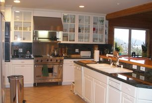 Traditional Kitchen with built-in microwave, Framed Partial Panel, Wall Hood, Built In Refrigerator, Raised panel, can lights