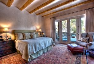 Eclectic Guest Bedroom with Brick floors, Carpet, French doors, Exposed beam