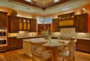 Traditional Kitchen with Flat panel cabinets, Stone Tile, Simple granite counters, High ceiling, Breakfast bar, Custom hood