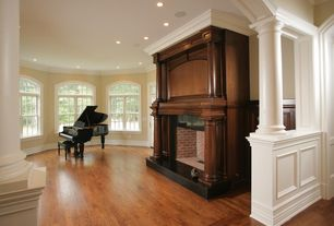 Traditional Living Room with Columns, Crown molding, Hardwood floors, Arched window
