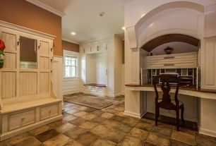 Traditional Mud Room with Window seat, Built-in bookshelf, terracotta tile floors, Crown molding