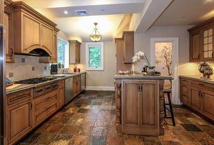 Craftsman Kitchen with Custom hood, U-shaped, Simple granite counters, quartz tile floors, two dishwashers, Breakfast bar