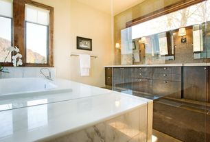 Contemporary Master Bathroom with European Cabinets, stone tile floors, Wall sconce, Flush, Standard height, drop in bathtub