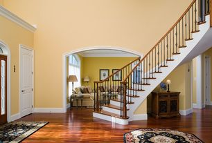 Traditional Entryway with Crown molding, specialty door, Transom window, French doors, Hardwood floors, High ceiling