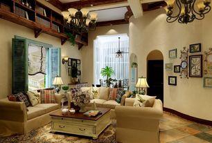 Mediterranean Living Room with stone tile floors, Arched doorway, Exposed beam, French door shutters, Paint, Casement