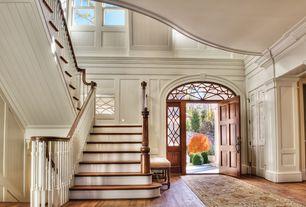 Traditional Entryway with Hardwood floors, six panel door, Transom window, High ceiling