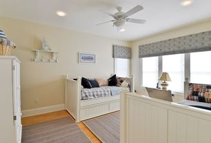 Traditional Guest Bedroom with Hardwood floors, Ceiling fan