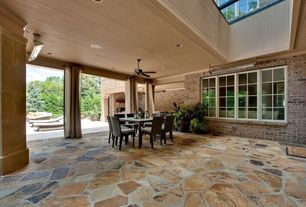 Contemporary Patio with exterior stone floors