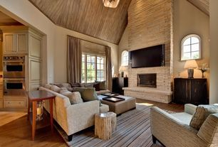 Contemporary Living Room with Pendant light, Club chair, High ceiling, Arched window, Upholstered sofa, Wall mounted tv