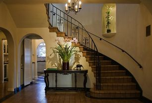 Mediterranean Staircase with Arched window, Chandelier, High ceiling, sandstone floors