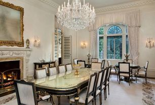 Traditional Dining Room with Wall sconce, Carpet, Crown molding, Transom window, Arched window, Glass panel door, Chandelier