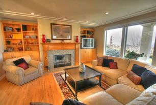 Eclectic Living Room with Built-in bookshelf, Fireplace, Standard height, metal fireplace, can lights, picture window