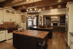 Eclectic Kitchen with High ceiling, Built-in bookshelf, 1920 spanish torch round chandelier, Concrete counters, Raised panel