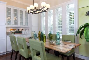 Contemporary Dining Room with Chandelier, Hardwood floors, Built-in bookshelf, Crown molding