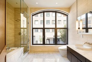 Modern Master Bathroom with Pental - motion porcelain tile collection, European Cabinets, Arched window, Vessel sink, Flush