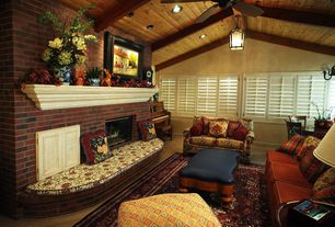 Country Living Room with Standard height, can lights, Exposed beam, Ceiling fan, Carpet, Built-in bookshelf, Fireplace