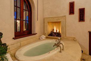 Mediterranean Master Bathroom with Master bathroom, Warner- tan faux marble wallpaper, Herringbone tile pattern