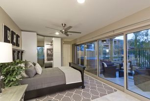 Contemporary Master Bedroom with specialty door, Ceiling fan, travertine tile floors