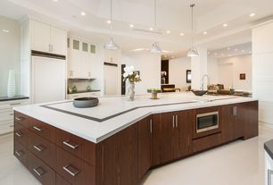 Contemporary Kitchen with Soapstone counters, Undermount sink, Flush, Pendant light, One-wall, Kitchen island, Glass panel