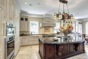 Traditional Kitchen with built-in microwave, Simple granite counters, Kitchen island, Raised panel, Breakfast nook, L-shaped