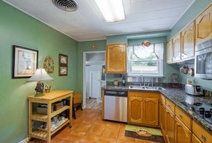 Country Kitchen with Paint, Crown molding, Standard height, terracotta tile floors, double-hung window, Built-in bookshelf