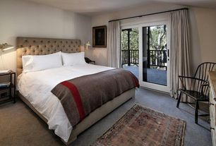 Traditional Guest Bedroom with sliding glass door, Paint 1, Carpet, Parsons Low Bookcase, Standard height