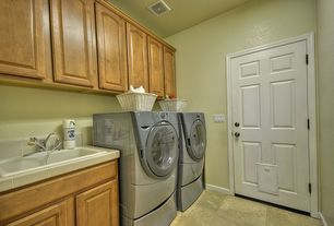 Traditional Laundry Room with Standard height, laundry sink, drop-in sink, Built-in bookshelf, Concrete tile , six panel door