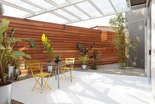 Contemporary Patio with Trellis, Fence, sliding glass door