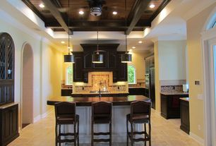 Mediterranean Kitchen with stone tile floors, French doors, electric cooktop, can lights, Paint, High ceiling, Breakfast bar