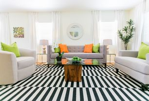 Living Room with Cost plus world market black and white striped dhurrie rug, Laminate floors, Bernhardt Turner Swivel Chair
