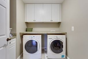 Contemporary Laundry Room with laundry sink, Built-in bookshelf, Standard height, six panel door, limestone floors