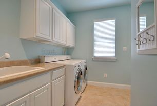 Traditional Laundry Room with travertine floors, Built-in bookshelf, Front loading washer and dryer