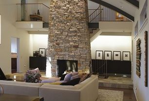 Contemporary Great Room with Cathedral ceiling, Exposed beam, stone fireplace, Hardwood floors, Fireplace, Loft, Paint