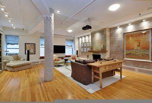 Modern Living Room with flush light, Box ceiling, Hardwood floors, interior brick, Window seat, Exposed beam, stone fireplace