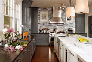 Contemporary Kitchen with Painted cabinets, Ceiling fan, Kitchen island, Daltile Caprice Contrast Blend, double oven range