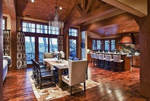 Rustic Dining Room with picture window, High ceiling, French doors, can lights, Transom window, Chandelier, Hardwood floors