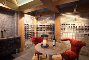 Contemporary Wine Cellar with Concrete tile , Custom Acrylic Wine Cellars, Olsen Upholstered Lounge Chair - Rose, flush light